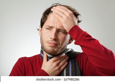 Man with headache and strong sore throat probably has cold