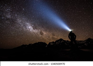 Man with headlamp watching Milkyway in Nelson lakes National park, South Island of New Zealand