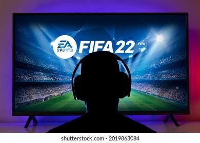Man with headphone play FIFA 22 on TV. 5th Aug, 2021, Sao Paulo, Brazil.
