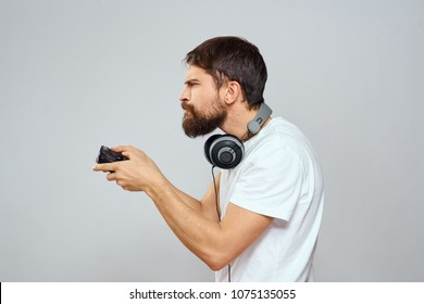 man in headphones, joystick, emotions