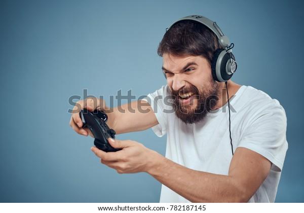 man, headphones, joysticks, technology