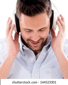 Man with headphones listening to music - isolated over white background