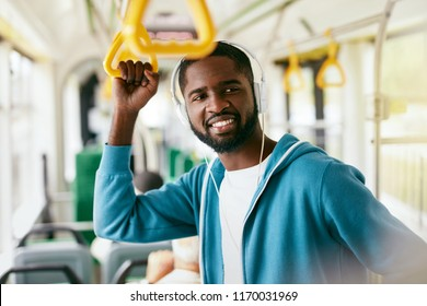 Man In Headphones Listening Music Riding In Transport