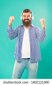 Man in headphones. Streaming music sites hippest and hottest around. Wireless technology. User friendly interface and large library of tunes. Hipster with beard listening music. Handsome music lover.