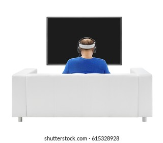 man with headphones and virtual reality glasses is sitting in front of the black screen