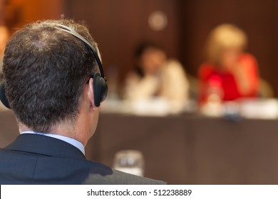 man with headset at the conference
