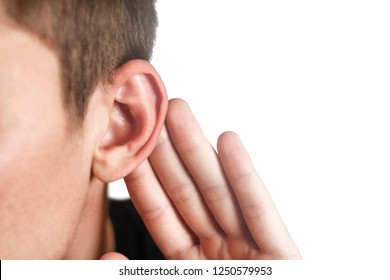 Man with hearing problem on white background. Close up.