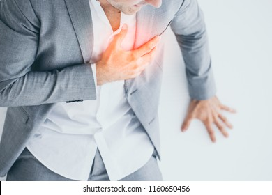 Man with heart attack pressing his hands to his chest.Close up Businessman has heart attack. Exhausted, Illness, disease, tired concepts.