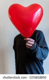 Man with heart balloon