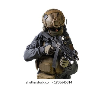 Man in a helmet aiming down