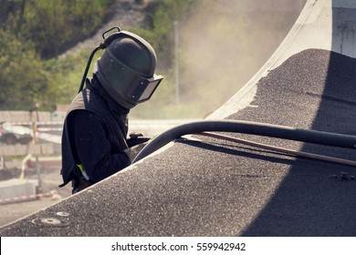 Man with helmet like robot working on a bridge construction