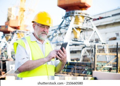 a man in a helmet with a tablet port