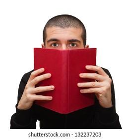 Man hiding behind a book