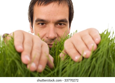 Man hiding behind grass blades - isolated