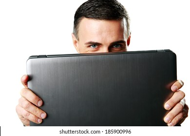 Man hiding behind laptop isolated on a white background
