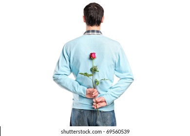 Man hiding a flower behind his back isolated on white background