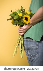 Man hiding sunflowers