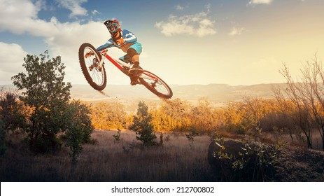 Man high jump on a mountain bike. Downhill cycling.