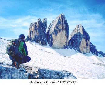 Man hiker with backpack on the Tre Cime di Lavaredo tour. beautiful surroundings at spring time, Dolomites in Italy, Europe