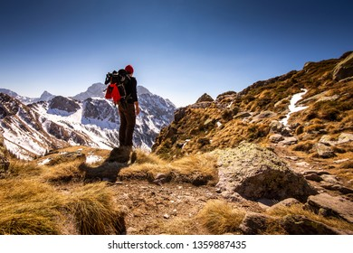 man hiker contemplate the landscape in mountain - time to disconnect concept