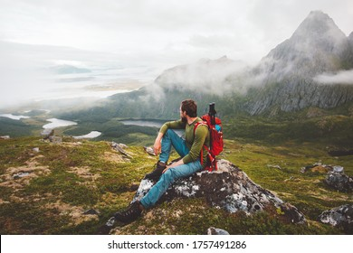 Man hiker exploring mountains of Norway Travel healthy lifestyle adventure trip hiking solo with backpack active vacations outdoor
