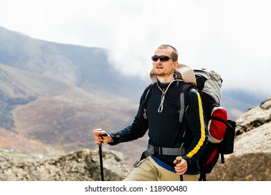 Man hiker hiking portrait in high Himalaya Mountains in Nepal. Trekking in summer nature