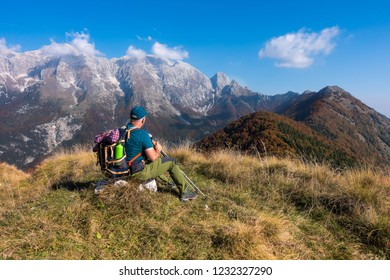 Man hiker sit and watch the landscape of  mountain in autumn from the mountain top