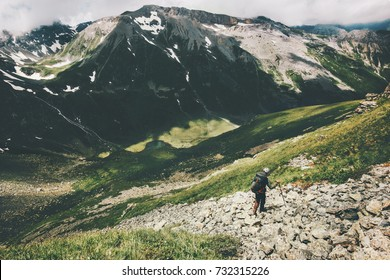 Man hiker trekking in mountains Travel Lifestyle adventure wanderlust concept summer vacations active outdoor wild nature
