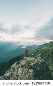 Man hiking alone in mountains adventure  solo traveling solitude lifestyle concept active vacations moody nature