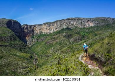 Man hiking to Cachoeira do Tabuleiro (Tabuleiro Waterfall) in Conceição do Mato Dentro, Minas Gerais, Brazil