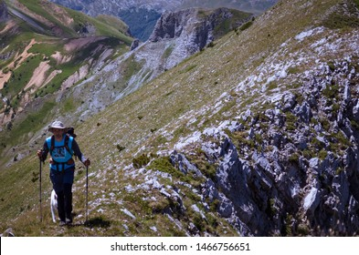 Man hiking with his dog in Prokletije mountain
