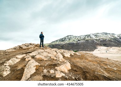 Man hiking in the mountains of Iceland in cloudy weather