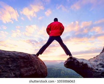 Man hiking in mountains, watching  sunset and horizon over beautiful landscape. Male hiker walking