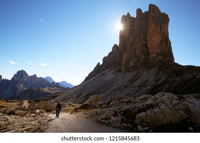 "A man hiking near the 'Tre Cime di Lavaredo' or "" Drei Zinnen "" - Dolomites - Italy"