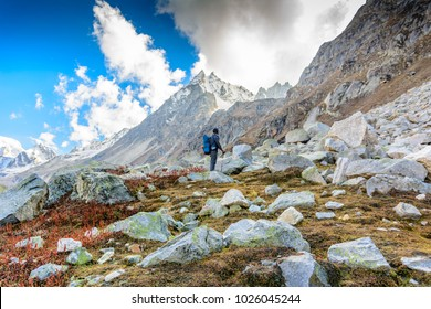 Man hiking on beautiful Himalayas mountains with backpack. Travel Lifestyle wanderlust concept