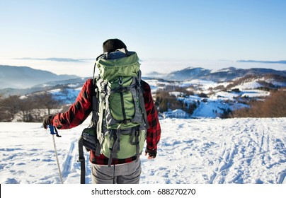 Man hiking on the top of snowy mountain