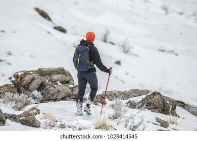 man hiking in snow mountain