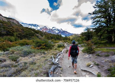 Man hiking trail towards Mount Fitz Roy in Patagonia in Argentina
