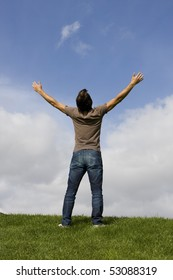 Man with his arms wide open enjoying life