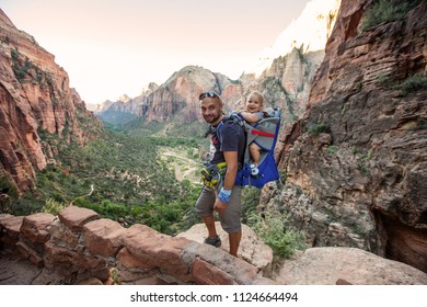 A man with his baby boy are trekking in Zion national park, Utah, USA