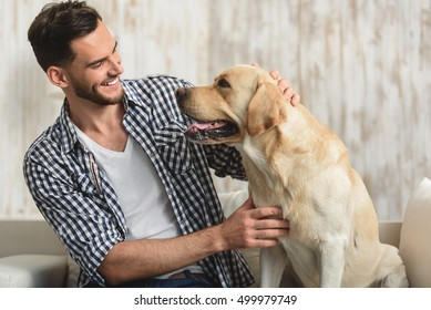man and his dog looking at each other