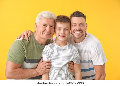Man with his father and son on color background