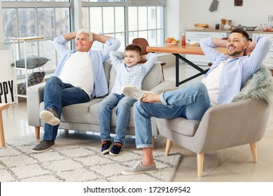 Man with his father and son resting at home