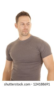 A man in his gray tight fitted shirt with a serious expression on his face.