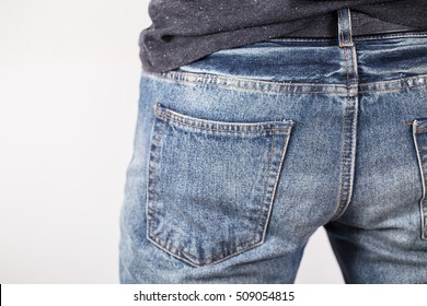 A man with his hands in jeans pockets