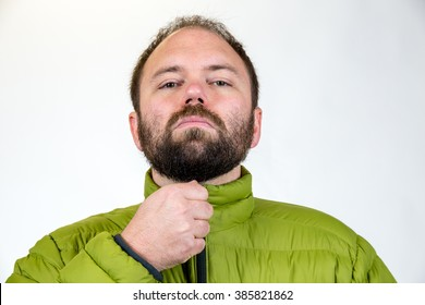 Man in his mid-30's poses for a studio portrait with a semi white background.