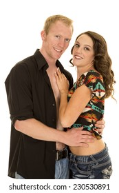 a man with his shirt undone holding his woman close.