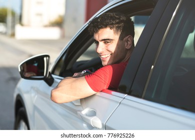 Man in his SUV automobile looking window outdoors