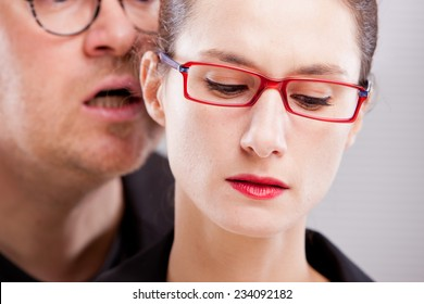 man hissing menaces in woman's ear because she can't resist
