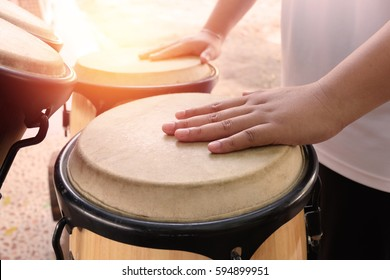 A man hitting an African drums. Play on a musical instrument Drummer.